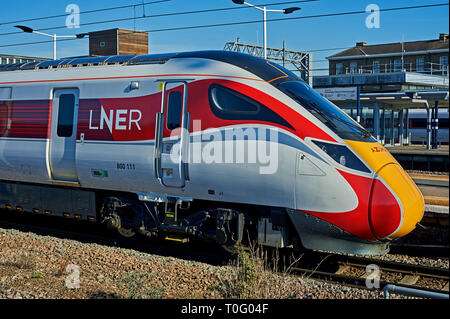 New Azuma streamlined trains in LNER railway livery at Peterborough station. - Stock Photo