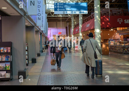 Washington, DC, USA --  March 16, 2019. Commuters walk briskly along past the shops in Union Station  in Washington D.C. - Stock Photo