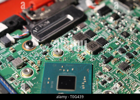 Closeup view at laptop motherboard and components. Processor or CPU as its brain. - Stock Photo