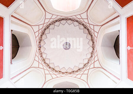 Worm eye view of the ceiling of the main shrine in Humayun's tomb in Dehli, India, with geometric arabic patterns. - Stock Photo