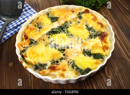Salmon - Fish Gratin with Spinach - Stock Photo