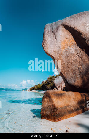 Huge beautifully shaped bizarre granite boulders in evening light at famous Anse Source d'Argent beach, La Digue island, Seychelles - Stock Photo
