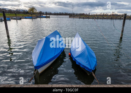 Two covered boats in a small harbour of Hard (Austria) on Lake Constance (Bodensee) - Stock Photo