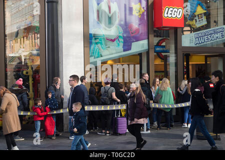 LONDON - FEBRUARY 15, 2019: Lego store on Leicester Square in a midday. Buyers stand in line to get to the store - Stock Photo