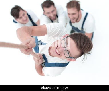 team, helping the leader to climb up the rope. - Stock Photo
