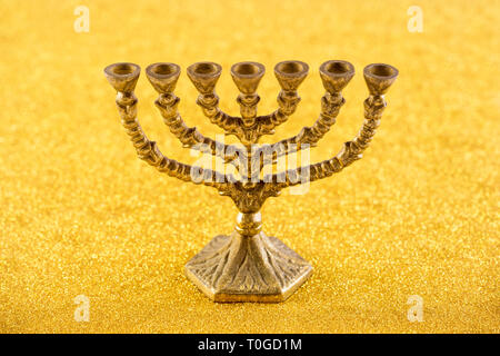 Menorah on golden background - Stock Photo