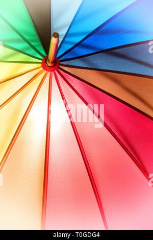 Rainbow umbrella close up. Texture and background - Stock Photo
