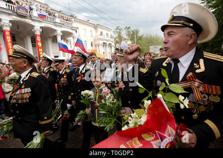 Veterans, officers, order bearers of the Black Sea fleet participate in the Parade of Winners on central street of Sevastopol city, Crimea 9.05.2014 - Stock Photo