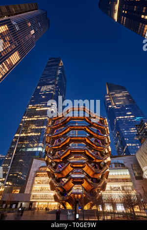 The Vessel, also known as the Hudson Yards Staircase (designed by architect Thomas Heatherwick) at dusk. Manhattan, New York City - Stock Photo