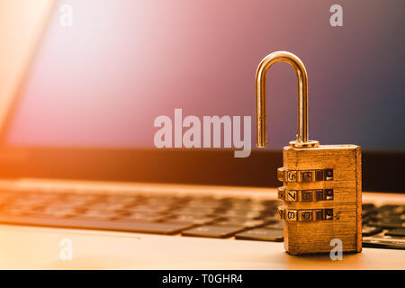 Computer information security and data protection concept, padlock on laptop computer keyboard.  Computer security protection from virus,  malware att - Stock Photo