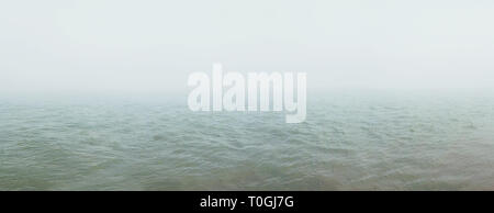 Thick fog spreads over the river. Natural background - Stock Photo