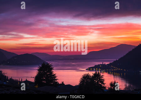 Lake Iseo at sunset with the town of Peschiera Maraglio on Monte Isola, Lombardy, Italy - Stock Photo