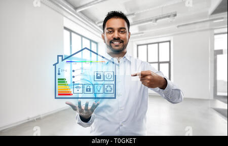 realtor with smart home projection at empty office - Stock Photo
