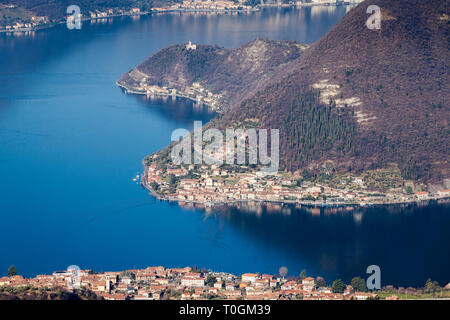 Lake Iseo with the village of Sulzano and Peschiera Maraglio on Monte Isola island, Lombardy, Italy - Stock Photo