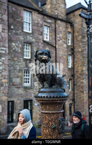EDINBURGH, SCOTLAND - FEBRUARY 9, 2019 - The statue of Bobby at the corner of Edinburgh's Candlemaker Row and George IV Bridge - Stock Photo