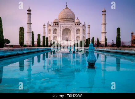 Beautiful view with long exposure of the famous Taj Mahal mausoleum in Agra, Uttar Pradesh, India, in the late afternoon light - Stock Photo