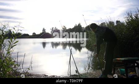 man fishing on the lake, have fun - Stock Photo