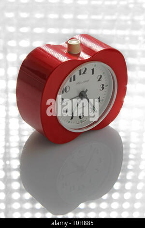 Vintage alarm clock apple inspired, isolated on white background, close-up - Stock Photo
