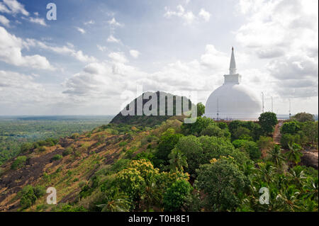 This large stupa known as the Maha Seya is on the summit of the Mihintale hill - Stock Photo