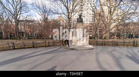 New York, NY - March 19, 2019: New Yorkers and tourist enjoy warm day at Washington Square Park - Stock Photo