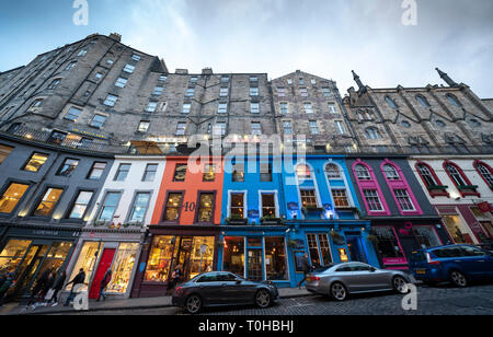 Dusk view of shops and restaurants on historic Victoria Street in Edinburgh Old Town, Scotland, UK