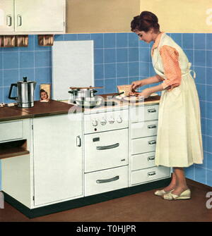household, kitchen, housewife with fitted kitchen, advertising, AEG electric range, version Record 2, original price 1957: from 300 DM, Germany, 1957, stove, stoves, range, electrical, electric, cook, cooking, cooking pot, cooking pots, preparing the meal, boil, boiling, boiled, preparation, preparations, dine, dining, household appliance, domestic appliance, household utensil, household appliances, domestic appliances, household utensils, woman, housewife, housewives, homemaker, apron, aprons, smock, smocks, kitchens, fitted kitchen, built-in ki, Additional-Rights-Clearance-Info-Not-Available - Stock Photo
