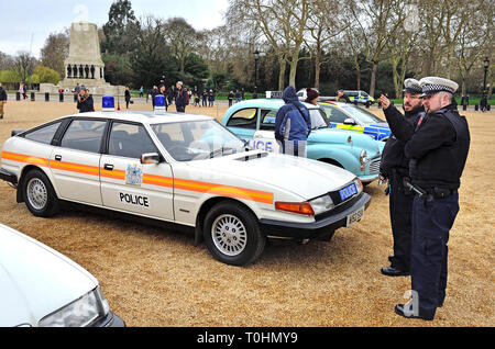 London, UK. 8th March 2019. Display of old Police Cars in Horse Guards Parade to coincide with a march to celebrate 100 years of women in the Metropol - Stock Photo