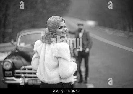 Photo girl, a man and a retro car. - Stock Photo
