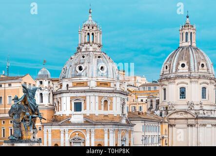 Close-up of two domes of ancient churches, in Piazza Venezia in Rome, with a bronze statue, in marble and stone, Chiesa di Santa Maria di Loreto Stock Photo