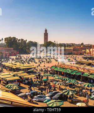 View of the busy Jamaa el Fna market square in Marrakesh, Morocco - Stock Photo