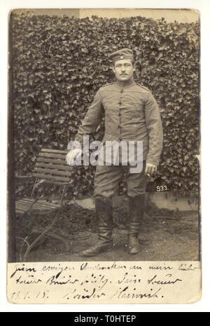WW1 postcard portrait of German soldier, Heinrich - wearing uniform, boots and hat, sent from Cassel, France to brother, Willy, in Verdun, N.E. France,  dated 13 Jan 1915 - Stock Photo