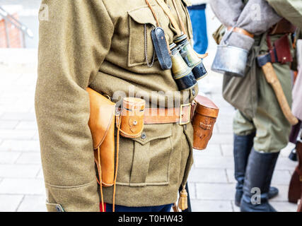 Vintage leather holster, binoculars and other ammunition on the belt. Retro uniform of russian army during Russian Civil War in 1918 - Stock Photo