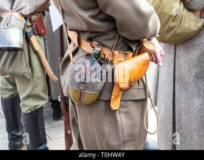 Vintage leather holster and other ammunition on the belt. Retro uniform of russian army during Russian Civil War in 1918 - Stock Photo