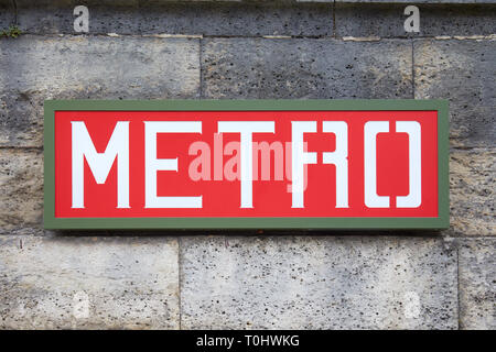 PARIS, FRANCE - JULY 22, 2017: Metro sign red and green on wall in Paris, France.