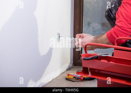 hands of an electrician at work - Stock Photo