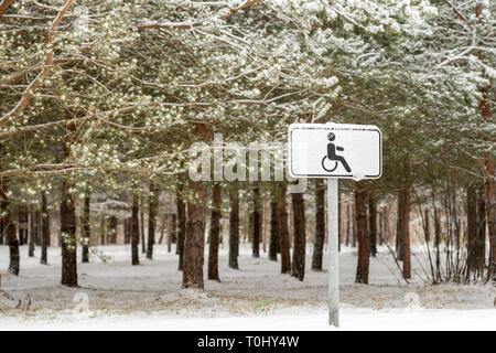 Disabled parking space sign on a pole warning motorists - Stock Photo