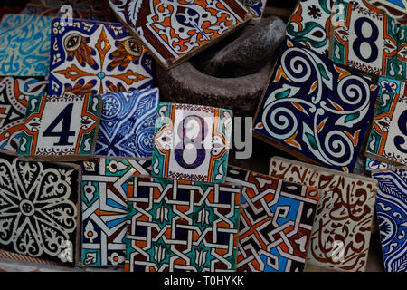 Traditional arabic handcrafted, colorful decorated tiles at the bazaar in Marrakesh, Morocco, Africa - Stock Photo