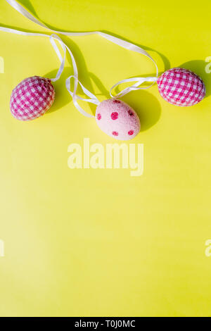 Easter card and eggs hanging on the clothesline.Easter. Easter symbol. Holidays card. Easter greetings.Copy space.Trendy flat lay easter. Minimal - Stock Photo