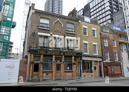 A row of terraced buildings & The Horse & Groom pub next to the site of William Shakespeare theatre 'The Curtain' Shoreditch London UK  KATHY DEWITT - Stock Photo
