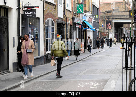 People walking along Rivington Street past boutique shops in Shoreditch East London UK  KATHY DEWITT - Stock Photo