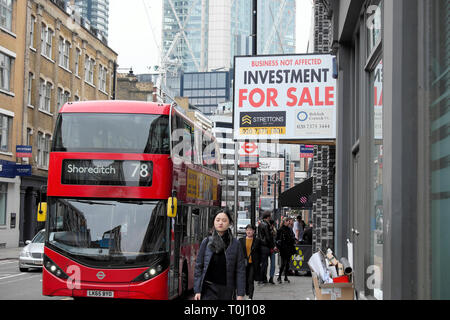 The 78 Shoreditch bus and property for sale investment sign in a street in East London UK  KATHY DEWITT - Stock Photo