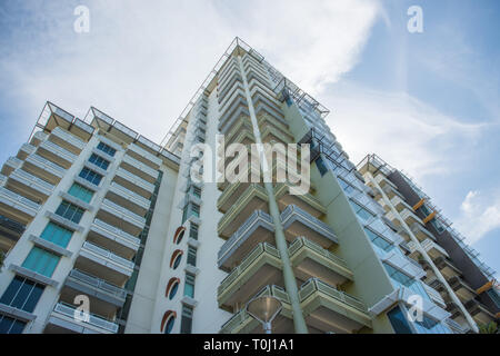 Darwin, Northern Territory, Australia-December 22,2017: 130 Esplanade apartments under a blue sky with clouds in downtown Darwin, Australia - Stock Photo