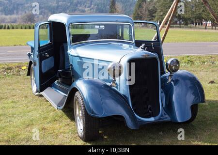 A vintage car on display at the Daffodil Festival in Junction City, Oregon, USA. - Stock Photo