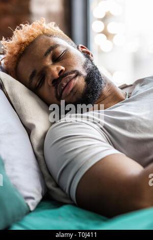 Close up of a pleasant sleeping man