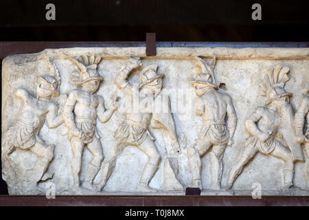 Carved Marble Frieze of Roman Gladiators from the Necropolis in Pompeii (on Display in the Colosseum Rome) - Stock Photo
