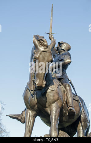 Statue of St George on horseback, part of the Cavalry Monument in Hyde Park, London. Sculpted by Adrian Jones, made from melted enemy guns and on publ - Stock Photo