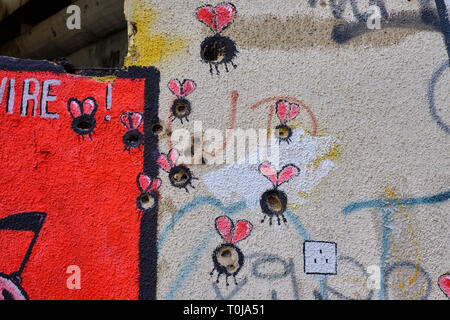 Wall art in Mostar, where the painter used bullet and shrapnel holes as part of design.  Bullet holes used as body of bugs - Stock Photo