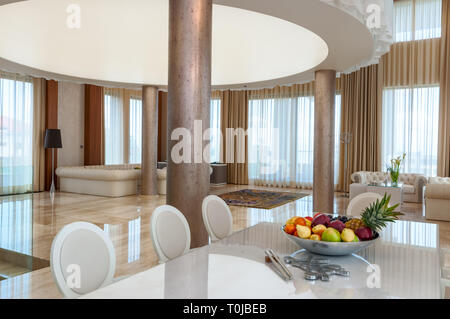 Luxurious marble interior in large spacious living room in modern contemporary house. Non US interior - Stock Photo