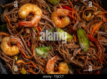 Stir fry noodles with shrimps and vegetables - Stock Photo