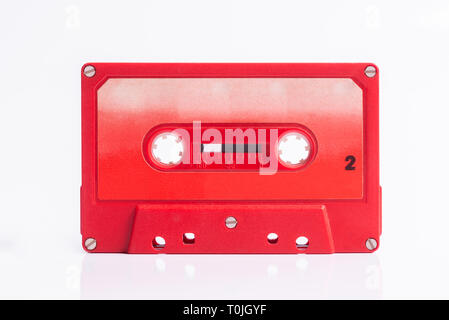 Audio Cassete Red on white background - Stock Photo